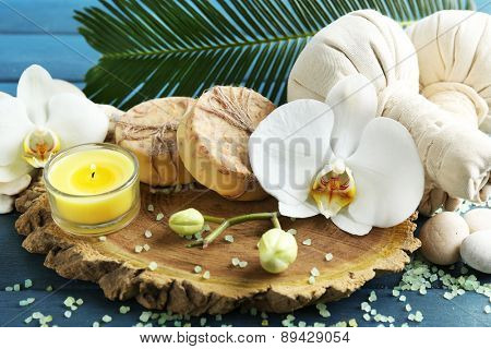 Still life with beautiful blooming orchid flower, spa treatment on wooden background