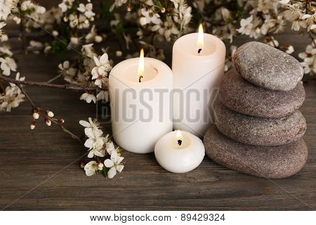 Spa still life with flowering branches on wooden table, closeup