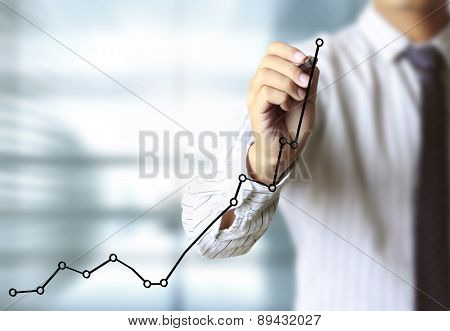 Business man drawing a graph