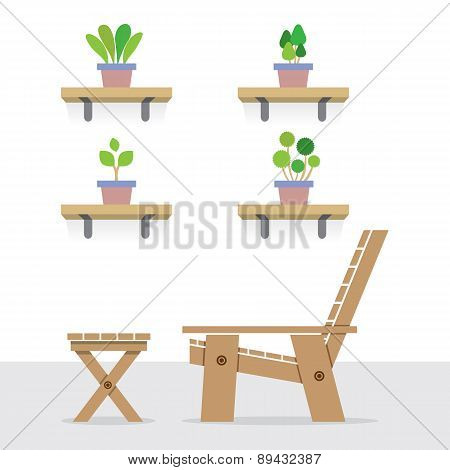 Pot Plants On Shelves With Side View Of Wooden Garden Chair And Table.