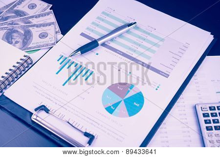 Business And Financial Report With Pen And Calculator On Wooden Table.document Is Mockup