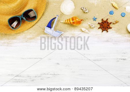 Travel accessories on wooden background