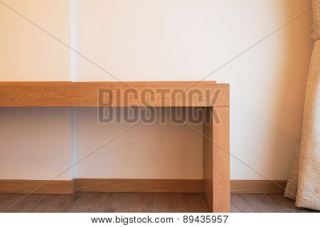 Closed Up Wood Table In Hotel Room