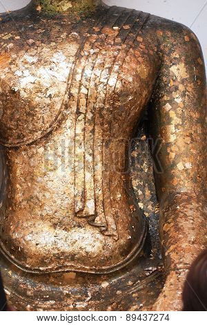 Closed Up Body Of Gold Buddha Statue