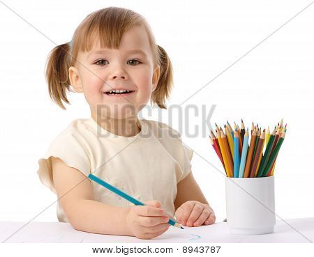 Cute Child Draws With Color Pencils