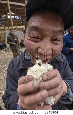 Asian Peasant Farmer Man Holding His Hands Handful Of Rice