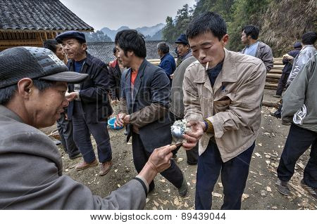 Chinese People Taking Rice His Hands On A Rural Celebration.
