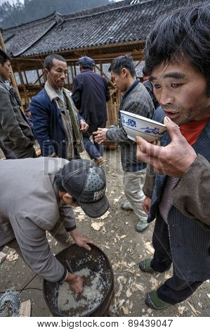 Asiatic Man Drinking By Cup On A Rural Feast.