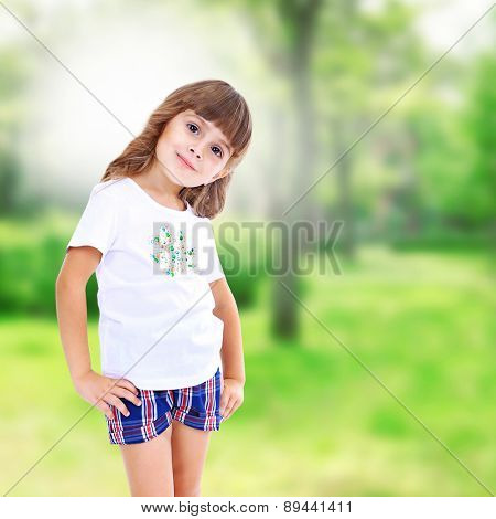Little girl posing on nature background