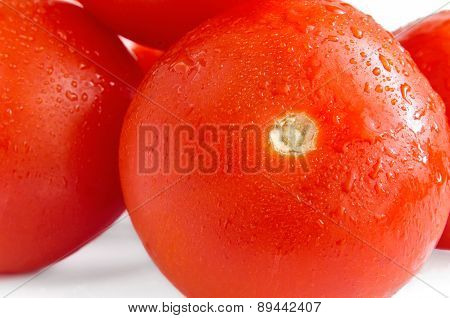 Tomatoes On A White Background With Water Drops Close Up.