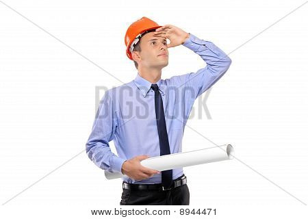 Construction Worker Holding Blueprints And Looking