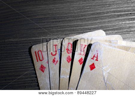 Playing cards on wooden background