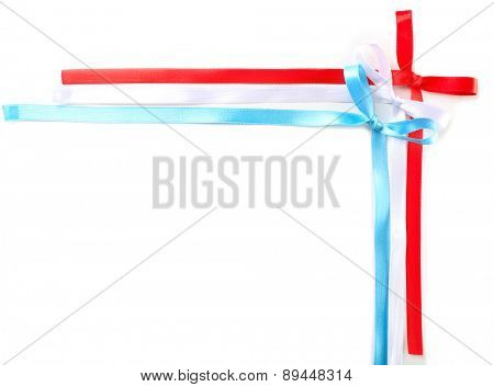 Frame of colorful ribbons with bow isolated on white