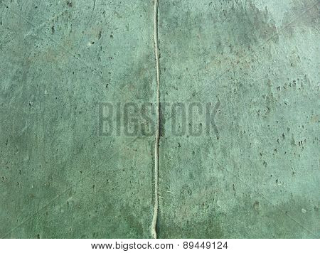 2 Bronze Panels Connected To Each Other  In Green
