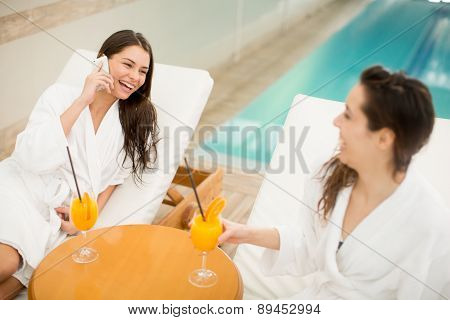 Young Women Relaxing By The Pool
