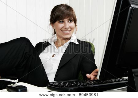 Young attractive businesswoman working at a computer