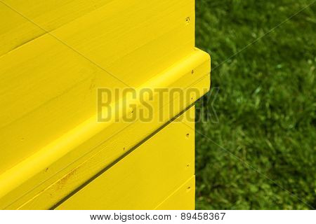 Part Of An Yellow Wooden Freshly Painted Beehive