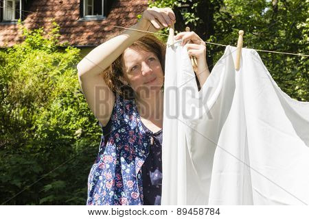 Hanging Up The Washing In A Garden