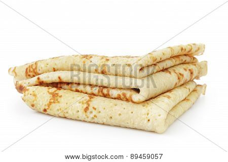homemade blinis or crepes folded, isolated