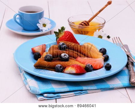 Pancakes And Honey Dipper On Blue Wooden