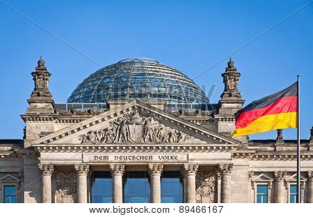 German National Flag Waving In Front Of German Parliament Building In Berlin