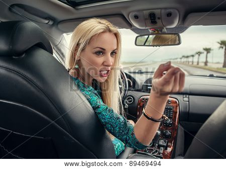 Attractive Blonde Female Emotional Talks To Rear Seat Passenger
