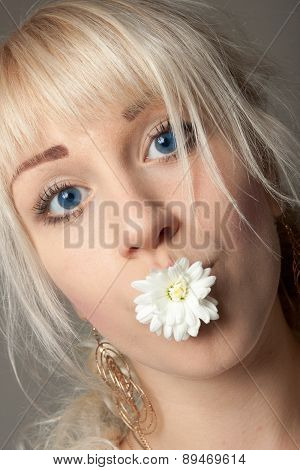 Woman with a Chrysanthemum in Her Mouth