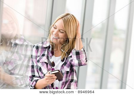 Happy Female Teenager With Mp3 Player