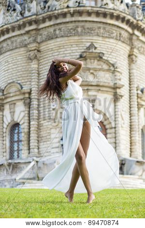 Sexy woman in a white dress on a background of the church