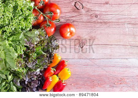 Three Lettuce Varieties With Tomatoes And Peppers