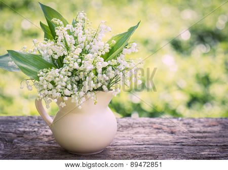 Beautifyl bouquet of lilies of the valley on the table