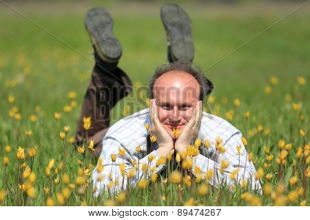 Happy man on nice flower meadow