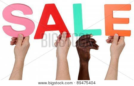 Multi Ethnic Group Of People Holding The Word Sale