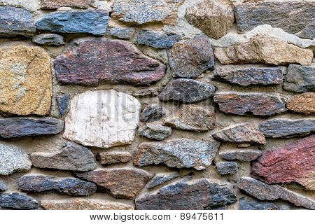 masonry multi-colored natural stone, symbol of texture, background, individuality