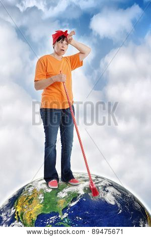 Mature Woman Trying To Clean The Earth