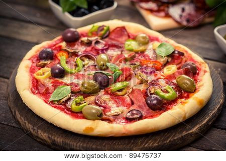 Homemade pizza with ham, cheese, vegetables
