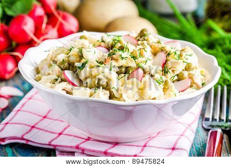 Potato Salad With Fresh Radishes And Dill In A White Bowl