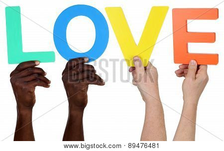 Multi Ethnic Group Of People Holding The Word Love