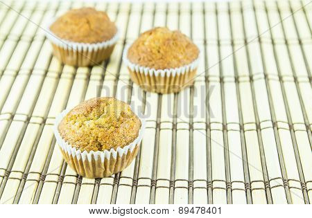 Banana Cup Cake On Wooden Background