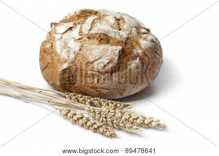 Traditional fresh round german crust bread on white background