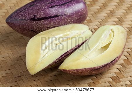 Fresh whole and partial pepino fruit