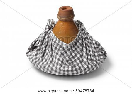 Traditional Moroccan tagine wrapped in a cloth as a gift and to keep warm on white background