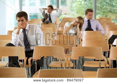 bored Business executives sitting in conference room