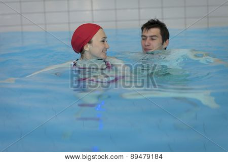 Couple in swimming pool