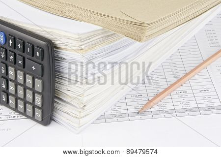 Envelope And Overload Of Old Paperwork With Vertical Calculator