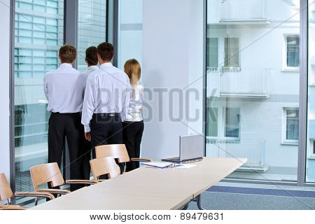 Business team looking through window at office