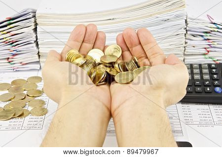 Man Hold Gold Coins Over Finance Account