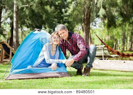 Portrait of romantic couple camping in park