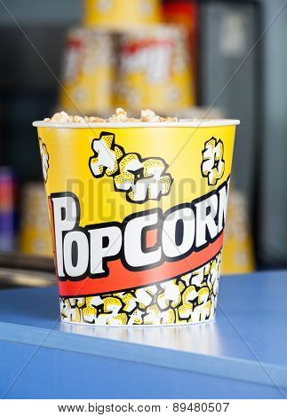 Bucket of popcorn on cinema concession counter