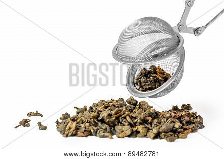 Green Tea And Strainer On White Background